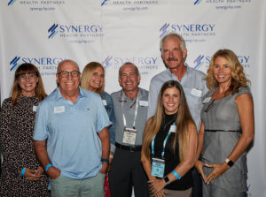 Synergy Health Partners staff pose at AAOS General Meeting Reception